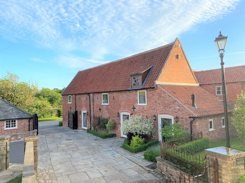 A Grade II listed Dovecote Barn set within Norwell