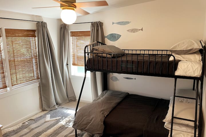 Large bedroom to the right that features a twin-over-full bunkbed with twin trundle under the bunkbed.