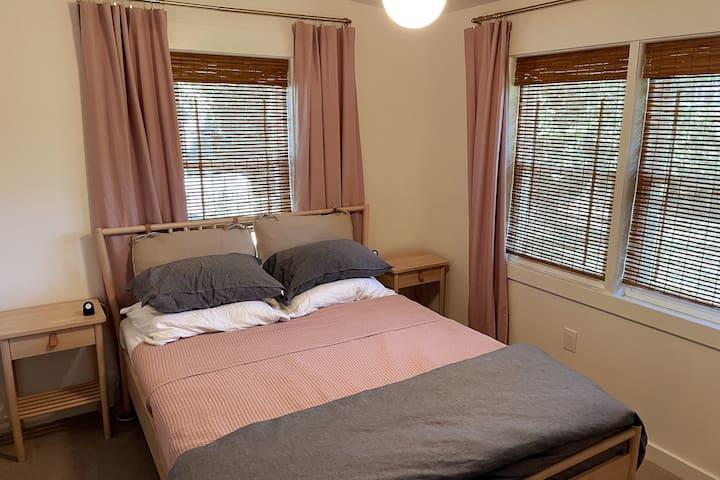 Queen bedroom is to the left of the hallway