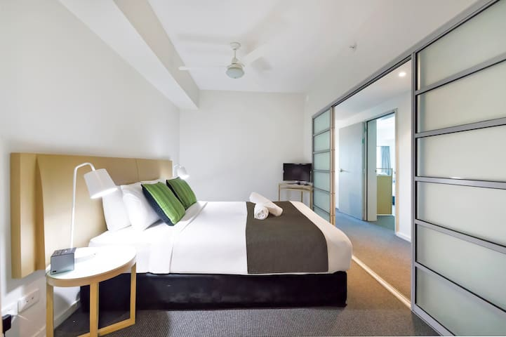 The main apartment bedroom comes with a premium queen-sized bed, topped with hotel quality linens for your stay. There is ample wardrobe space for your belongings and a private ensuite bathroom.