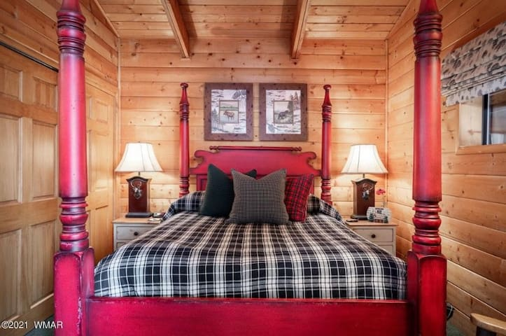 Bedroom #1 which includes french doors leading out to porch