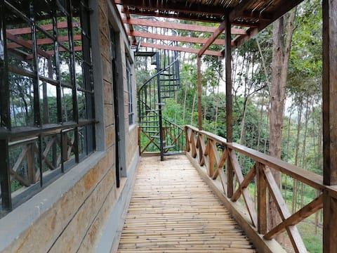 Leafy deck Cottage in Forest at Kihingo Cottages