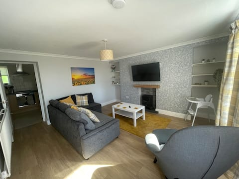 Immaculate one bedroom home with private parking