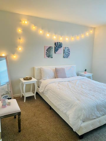 Cozy bedroom with a full size bed, double nightstands and full length mirror!