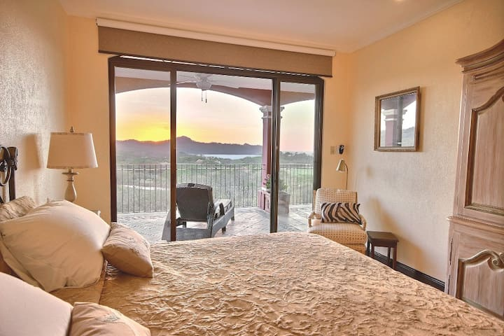 Master Bedroom # 1. Private access from outside covered parking.  One way locking door between Master and Condo.  Patio Access. Overlooking the pool and 18 hole golf course while watching the sunset on Flamingo Bay.