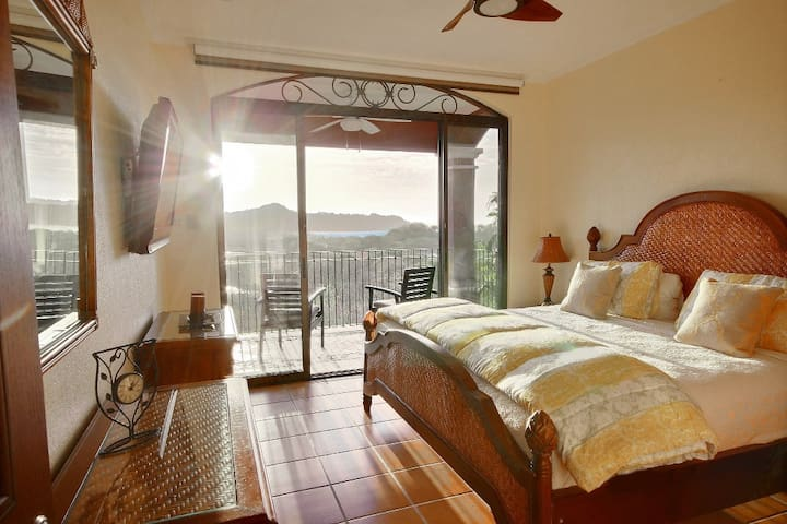 Second Master Bedroom, Patio access.  Over looking the pool and 18 hole golf course while watching the sunset on Flamingo Bay.