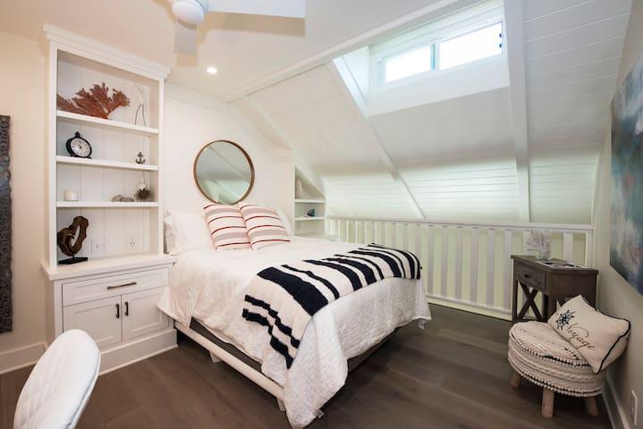 Loft style bedroom. Queen bed. Walk-in closet.