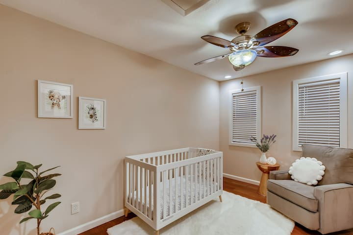 NURSERY with reclining rocking chair, nightlight and blackout shades for those afternoon naps.