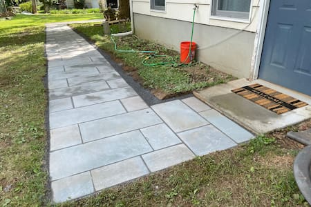 4 foot wide bluestone walkway from the end of the driveway to the door. Doorway 36 inches wide.