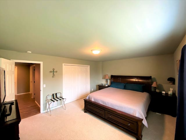 Private large bedroom with king sized bed.