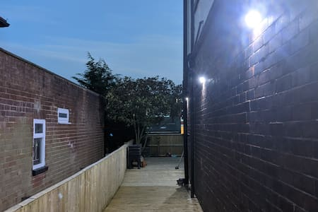 Access to the key safe is through the decking on the side of the house. It's well lit with solar lights which automatically turn on when a movement is detected.