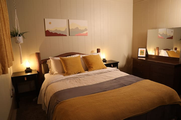 The super cozy yellow room - if you like it dark so you can sleep in, or you like a firm mattress, this is the room for you.