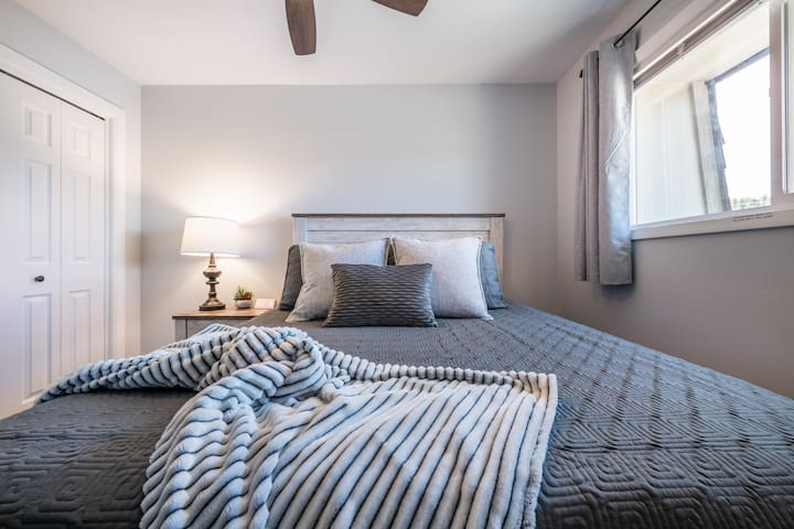 The 3rd bedroom is cozy and full of touches! The window bathes the room in light during the day (with stunning views of Pikes Peak), but as in all the bedrooms, the use of shades and blackout curtains allow for the room to be darkened at night.