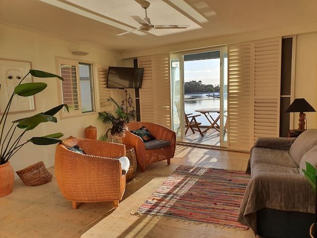 Lounge room with a view over the marina and  includes a pull out double sofa bed .