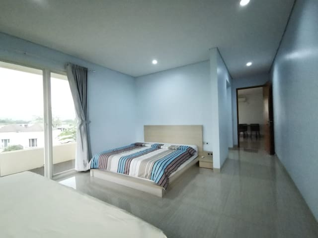 Spacious master bedroom with walk-in closet, attached bathroom, 1 king-size very comfy bed, 1 extra large (140x200) single bed with sliding bed below, wide windows for fresh air and best-view balcony.