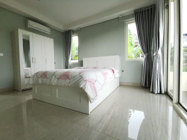 The other one of the most comfortable twin bedrooms, each with a queen-size bed & a 3-door cabinet.