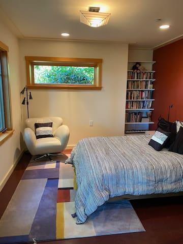 Guest bedroom queen Casper bed overlooking beach-no window coverings