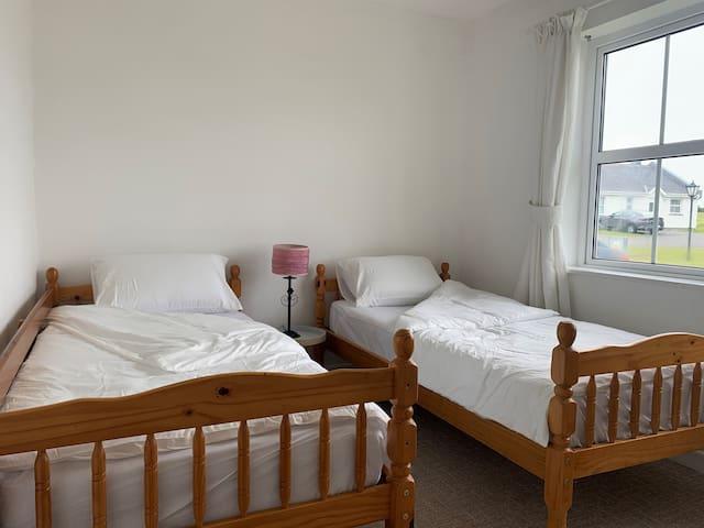 Twin Bedroom with Wardrobe & Storage