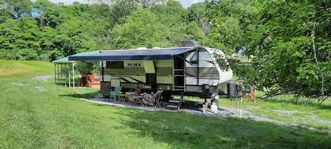 RV Camping by Fruit Trees