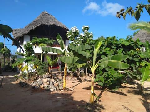 Maua Mazuri - Garden bungalows close to the beach