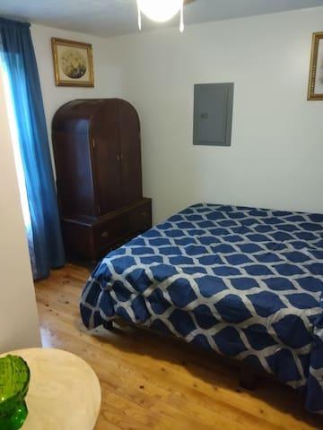 Queen size bed TV in dresser.