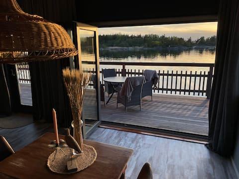 Di pantai dengan pemandangan laut, sauna & jeti pemandian