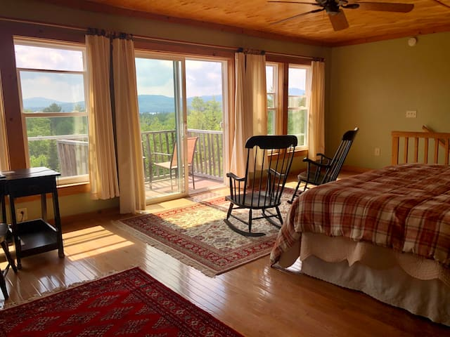 Master bedroom with sweeping views of Bald Mountain, Azizscohos Mountain and Deer Mountain