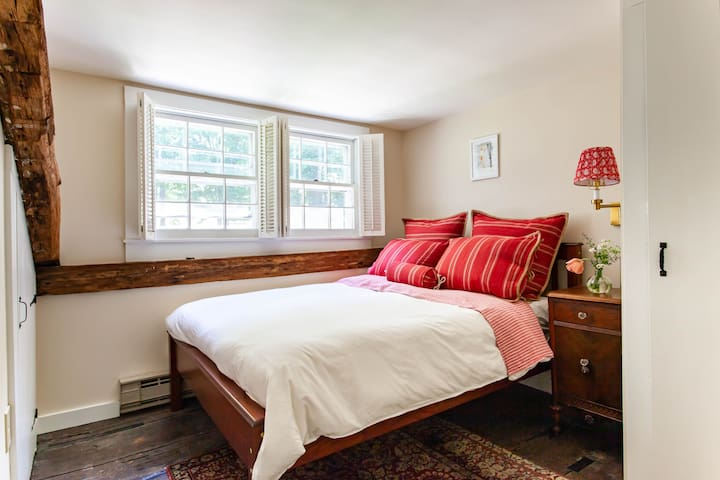 Upstairs double bedroom with views of the pool and wheat field.