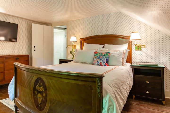 """Upstairs Queen bedroom with 55"""" tv."""