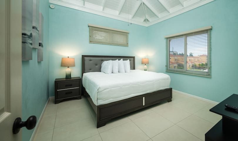 Master Bedroom with King size bed AC and 40 inch smart TV