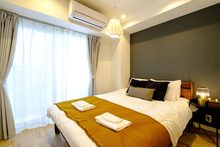 1st bedroom with 1 double bed with A/C unit.