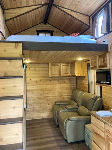 """Fully lined with cedar, it smells like walking into a cedar chest! Movie theater recliners and a tv/dvd player for """"movie night"""". Kitchenette includes sink, microwave, refrigerator and coffee maker. Service for two. Also outdoor grill for cooking"""