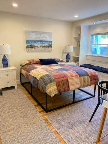 Downstairs bedroom with queen bed, desk