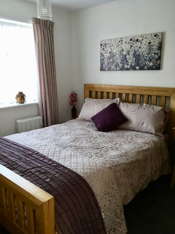 Back bedroom with king size bed. Large oak wardrobe, side dressing table with drawer (can be used as a desk if required) with large round mirror over and a stool. Also bedside table on other side of bed.