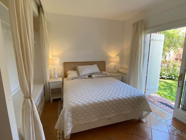 Master bedroom facing a private garden