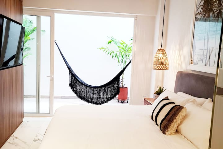 Relaxing King Bed, 55 inch TV with Hammock on Patio. Whatever you are in the mood for.