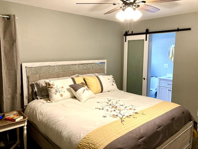 Master Bedroom - King size bed with black-out drapes