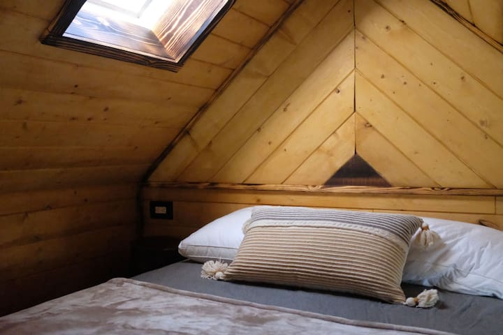 Relax in the cozy loft with a skylight and window that you can overlook the city lights when you sleep. Dimmable lights to set the mood :)