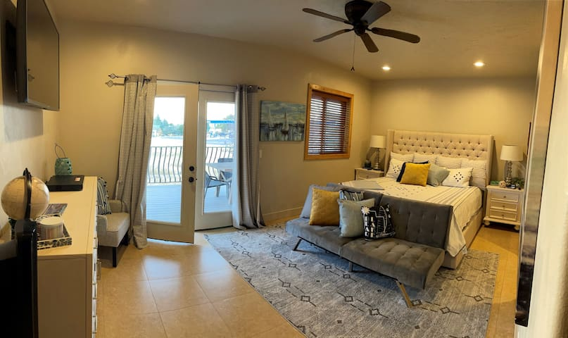 Master bedroom with King bed, charging docks, double futon, and a pack-n-play crib stored in the closet. Opens up to main deck with an amazing lake view.