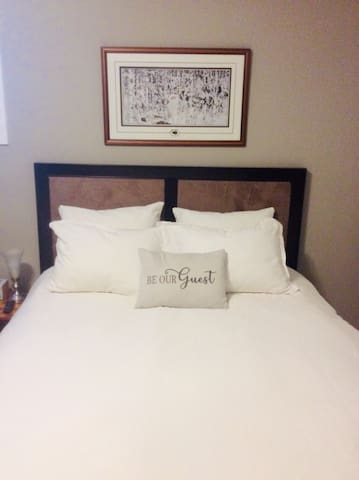 Comfy Queen Bed with white linens