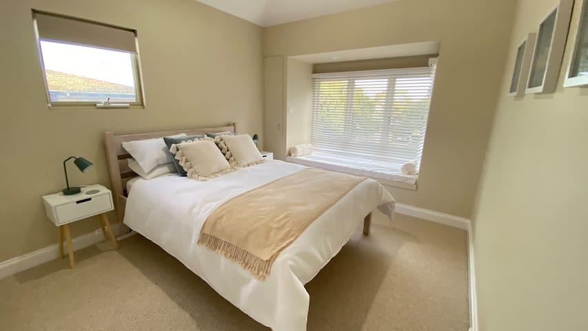 Queen bedroom with window seat