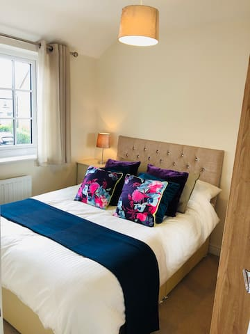 Double bed in Bedroom 2 with a large wardrobe.