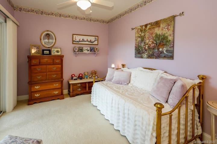 Another solid brass bed in the downstairs Lavender Garden room.  There is a trundle located underneath the day bed and the swing bed is just outside the sliding glass doors to this room.