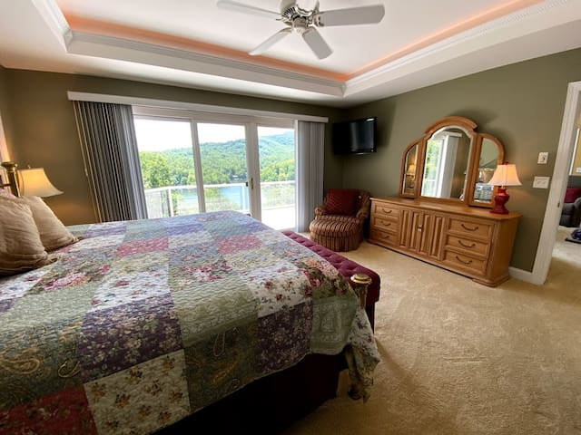 A solid brass bed and a quilt  finish off the coziness of the Master Suite.  If you leave the blinds open you will wake up to this view without having to leave bed.