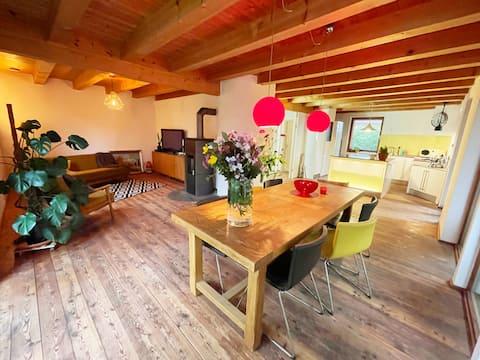 Casa de madera ecológica sostenible con jardín en Allgäu