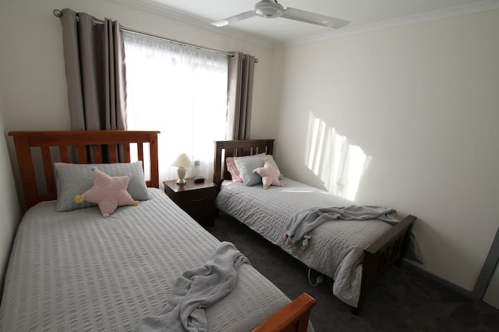 Bedroom 3 has a king single and a single bed  with double bed doonas, and a built in wardrobe. Includes split system air conditioner, ceiling fan and extra blankets.
