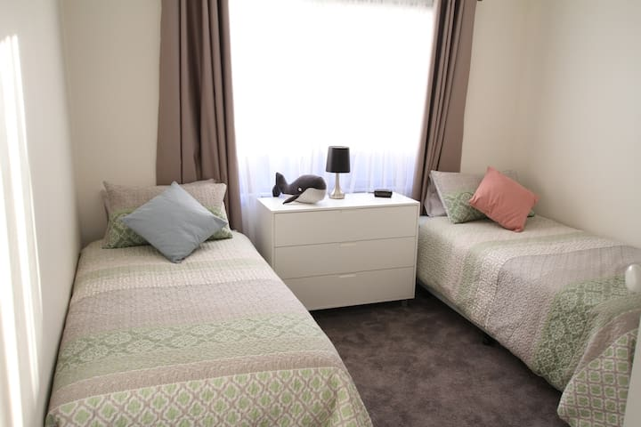 Bedroom 4 has twin single beds with double bed doonas for extra comfort and a built in wardrobe with shelves. It has split system air conditioner, ceiling fan and extra blankets.