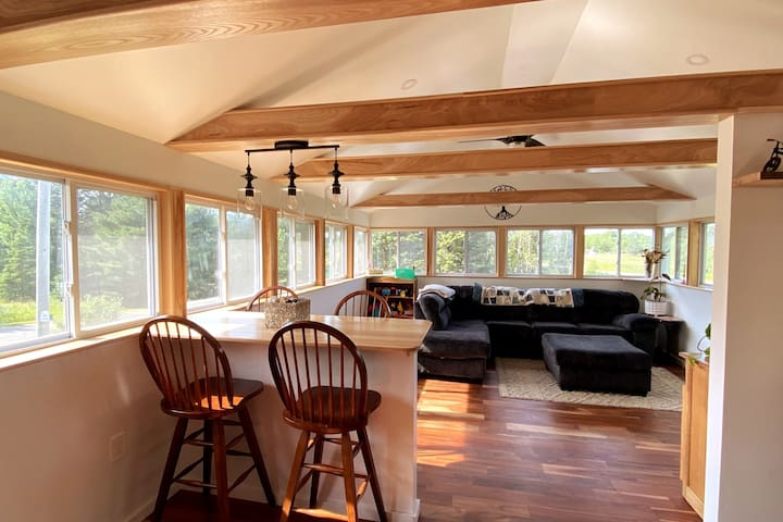 Enter into our newly remodeled sunroom! It is the best place to play games, have some wine, or simply relax during a spring rain.