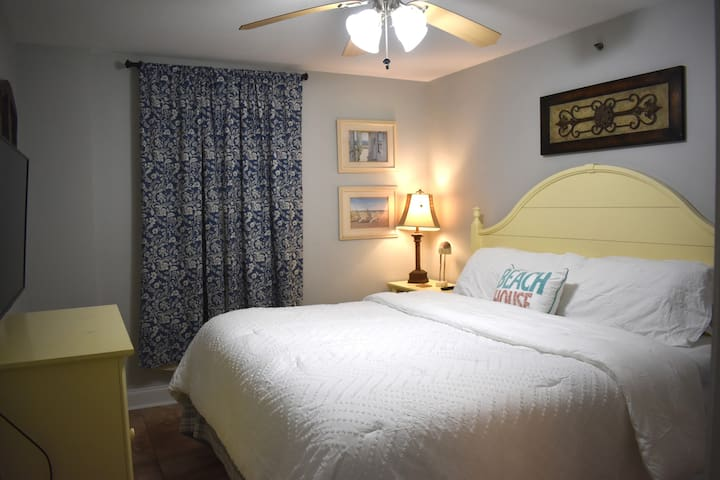 Master Bedroom with private full bathroom. Don't get lost in the King sized mattress!
