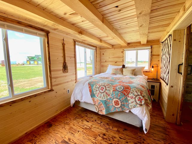 Bedroom with a queen bed and fire stick TV